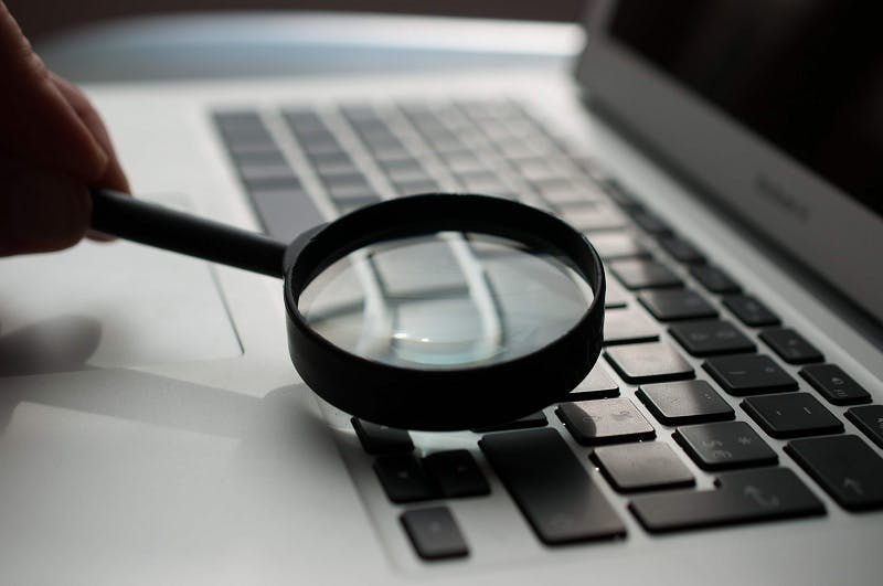 Online legal research magnifying glass computer