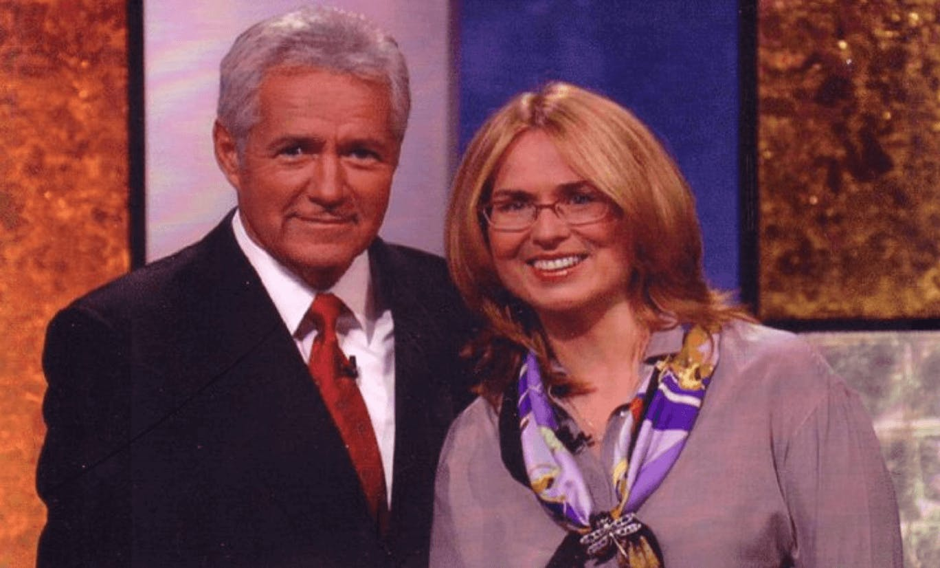 Carly on Jeopardy! with Alex Trebek.