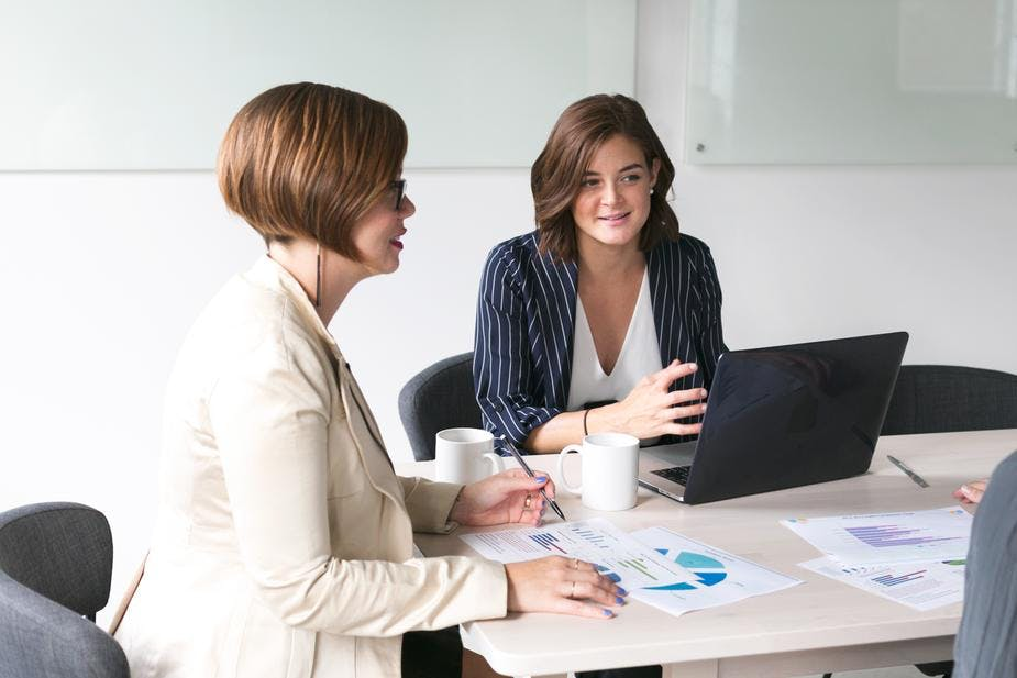 Two women consulting